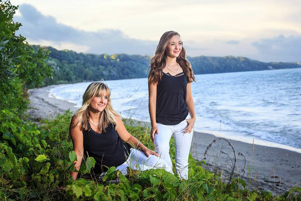 Mother and Daughter photographed on the cliff by the seashore